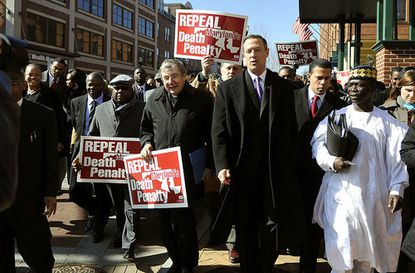 Gov. Martin O'Malley (center) and Lt. Gov. Anthony Brown (second from right) lead a march down West Street in Annapolis to urge lawmakers to repeal the death penalty in Maryland.