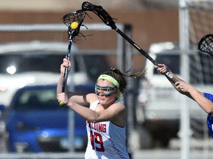 Spalding's Kristin O'Neill shoots and scores in the first half against St. Mary's in a girls high school lacrosse game.