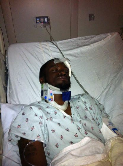 Joshua Ceasar is shown in a hospital bed after being attacked at Morgan State University by Alexander Kinyua, who was later charged with killing a housemate and eating part of the body.