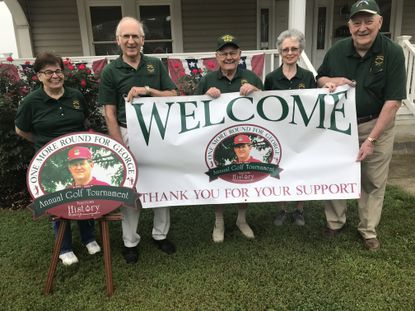 Patty Fazenbaker, from left, Carroll Hahn, George Naylor, Sandy Crouse and Kenneth Crouse show a banner for the One More Round for George golf tournament, which will be held Sept. 20.