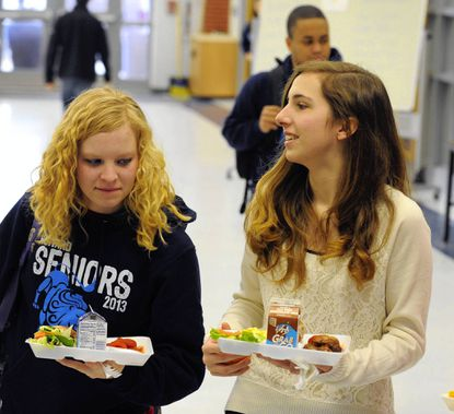 Laura Harrison, left, and Katherine Elicker buy lunch at Howard High School in 2013. (File)
