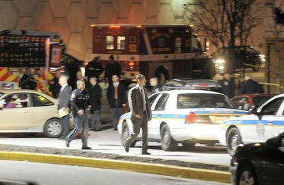 Baltimore County police investigate a shooting scene outside Nordstroms at Towson Town Center Monday night.
