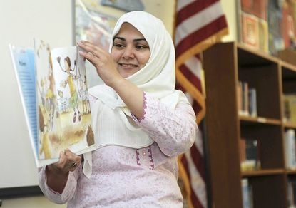 Ambareen Jafri, winner of the Comcast Parent Involvement Matters Award, reads to a class at Nantucket Elementary School, where her son is a third-grader.