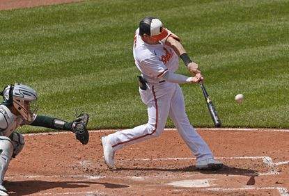 Orioles' Austin Hays, right, connects for a two-run home run against the A's in the fourth inning. He had two home runs in the game.