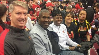 The parents of Kevin Huerter, Darryl Morsell and Anthony Cowan Jr. -- Tom Huerter, Duane and Carolyn Morsell, and Traci Cowan -- as well as Cowan's grandmother, Valencia Skeeter, sit courtside at Value City Arena in Columbus, Ohio, for Maryland's game on Jan. 11 at Ohio State.