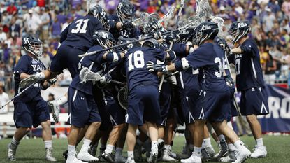 Yale players celebrate after defeating Albany, 20-11, in an NCAA semifinal Saturday. The Bulldogs (16-3) have been the most balanced team this season.