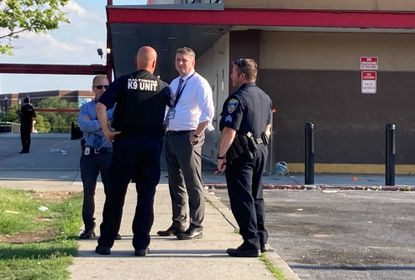 Police investigate a shooting at a Dunkin Donuts at the Mondawmin Mall this afternoon.