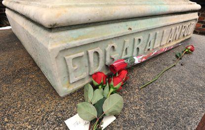 Roses lay on Edgar Allan Poe's grave site.