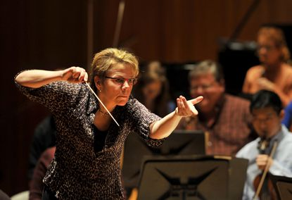 """Baltimore Symphony Orchestra conductor Marin Alsop during a rehearsal of Britten's """"War Requiem."""""""