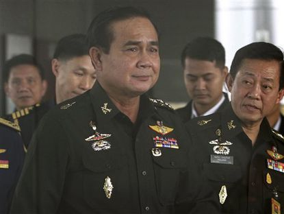 FILE - In this June 13, 2014 file photo, Thailand's Army commander Gen. Prayuth Chan-ocha arrives at the Royal Thai Army Club in Bangkok. Gen. Prayuth, who seized power in a coup in May, said Friday, June 27, 2014, a temporary constitution will allow an interim legislature and Cabinet to begin governing the country in September. He said an appointed reform council and constitution drafting committee will then work on a long-term charter to take effect July 2015. (AP Photo/ASTV Manager newspaper, File) THAILAND OUT