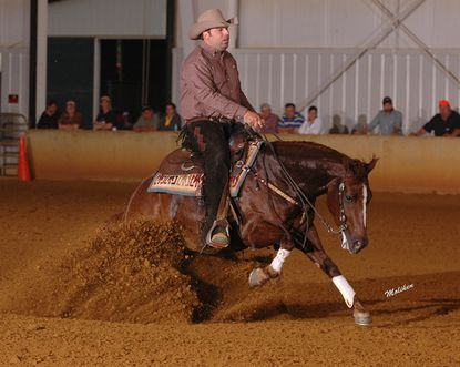Chic With Chex is shown being ridden by trainer Martin Audet. Chic With Chex is the 2013 world reining champion in the National Reining Horse Association's Intermediate Open Class.