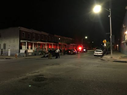 Police respond to a shooting in the 1400 block of N. Milton St. on Tuesday night. One man was shot in the chest and taken to Shock Trauma.