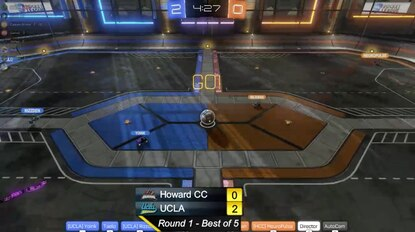 """Howard Community College had its esports debut Thursday night in a 3-0 loss to UCLA in the video game """"Rocket League."""" In a screen grab from HCC's broadcast Sept. 3, the two teams of three players each compete in cars over a soccer ball to score goals."""