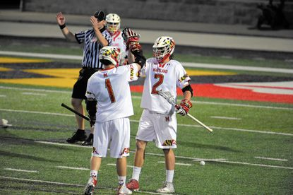 Maryland Terrapins' Colin Heacock (2) celebrates his extra man goal after being assisted by Matt Rambo (1) during men's college lacrosse in College Park. The Terrapins held on to win, 10-7.