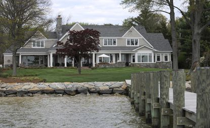 The rear yard of Ward and Ginny Westrick's dream home overlooks the water and the docking pier.
