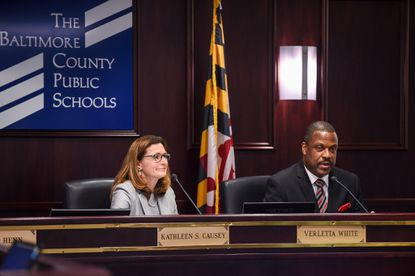 Darryl Williams, the superintendent for Baltimore County Public Schools, sits at a school board meeting with Kathleen S. Causey, chair of the Baltimore County Board of Education.