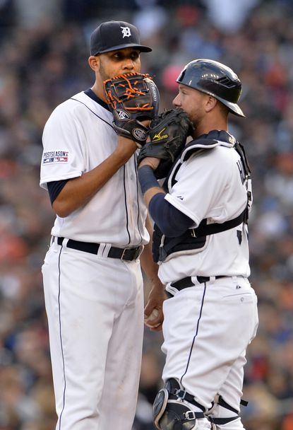 Tigers pitcher David Price and catcher Bryan Holaday gather at the mound during Game 3 of the ALDS.