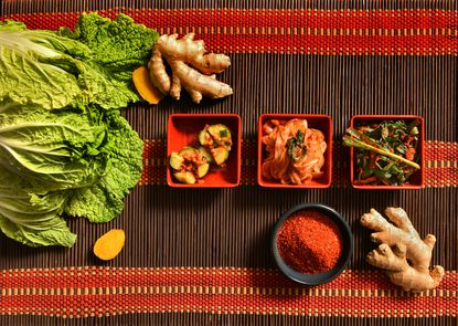 From left, cucumber kimchi, traditional cabbage kimchi and chive kimchi from Lotte Plaza in Howard County.