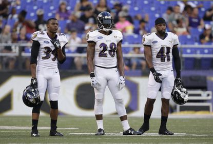 Left to right: Ravens defensive back Tramain Jacobs defensive back Brynden Trawick and cornerback Anthony Levine during open practice at M&T Bank Stadium.