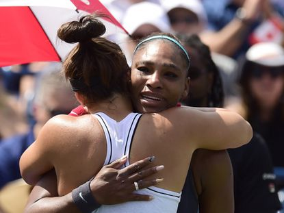 Canada's Bianca Andreescu, left, consoles Serena Williams, of the United States, after Williams had to retire from the final of the Rogers Cup tennis tournament in Toronto, Sunday, Aug. 11, 2019. (Frank Gunn/The Canadian Press via AP)
