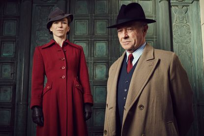 "Michael Kitchen as Christopher Foyle and Honeysuckle Weeks as Samantha Wainwright in ""Foyle's War"" on Acorn TV."