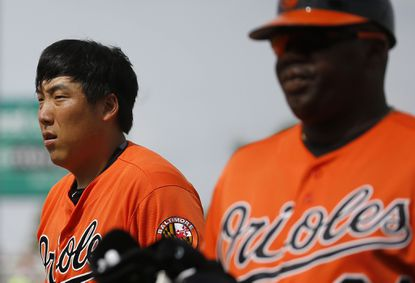 Orioles' Hyun Soo Kim, of South Korea, walks off the field after being thrown out at first base during a spring training game against the Minnesota Twins in Fort Myers, Fla., Saturday, March 5, 2016.