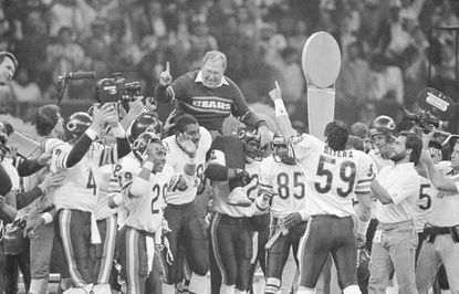 Chicago Bears defensive coordinator Buddy Ryan is carried off the field by the team after the Bears beat the New England Patriots 46-10 in Super Bowl XX on Jan. 26, 1986, in New Orleans.