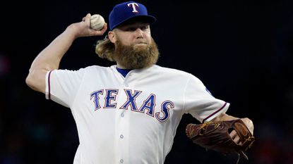 Texas Rangers starting pitcher Andrew Cashner throws during the first inning against the Oakland Athletics in Arlington, Texas, in September 2017.