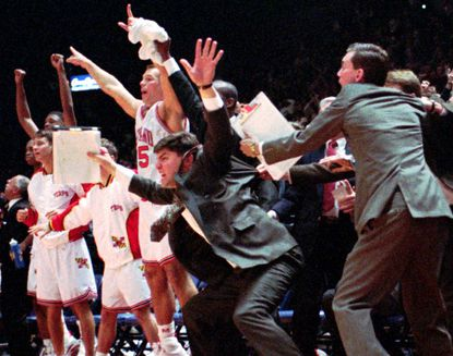 Maryland players and coaches try to stay near the bench as the clock winds down in their overtime win over the Georgetown Hoyas inLandover, Friday, Nov. 26, 1993.