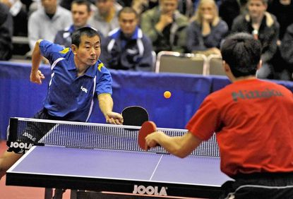 Liu Song, left, of Team JOOLA, wins a semifinal match, 3-2, against Gao Hua Jiang, right, of East China University 1 team at the Joola North American Teams Table Tennis Championships at the Baltimore Convention Center.