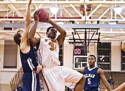 McDonogh's Kayel Locke goes up for a basket with Gilman's Ryan Ripken defending and teammate Cyrus Jones watching in the Eagles' 68-67 victory Thursday night.