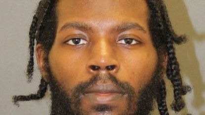 Ruben Jackson Jr. 28 of Baltimore, was found guilty of shooting his father, rolling his bloody body into a blanket then trying to hide it in the family's basement. His mother - the victim's wife - found her husband's body a day later.