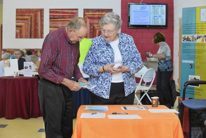 Judy Pitman talks with Robert Styer, of Woodbine, at a presentation on The Village in Howard at Glenwood 50+ Center, which is recruiting volunteers to help seniors who want to stay in their own homes.