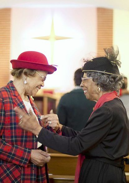 Maxine Nicholas, left, of Lauraville, greets Elizabeth Wheeler, of Govans, at Pleasant Hope Baptist Church near Belvedere Square on Feb. 19. The church hosted a Black History Month event to highlight the area's past.