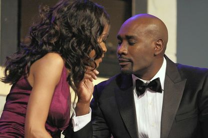 """Morris Chestnut (right) stars in """"What My Husband Doesn't Know"""" with Michelle Williams (left). The play comes to the Lyric Opera House this weekend."""