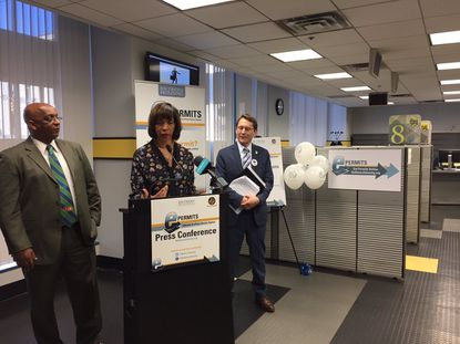 """Baltimore Mayor Catherine Pugh (center) announced a new electronic building permit system in Baltimore. She's joined by City Council President Bernard C. """"Jack"""" Young (left) and Acting Housing Commissioner Michael Braverman."""