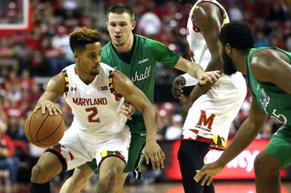 Maryland guard Melo Trimble (2), left, drives the ball against Marshall guard Stevie Browning (2), second from left, and forward Ryan Taylor (25), right, in the first half, Sunday, Dec. 27, 2015, in College Park.