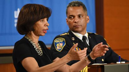 """Mayor Catherine Pugh and Police Commissioner Darryl DeSousa during """"Baltimore Standing Together, a town hall on crime sponsored by WJZ, The Baltimore Sun and the University of Baltimore."""