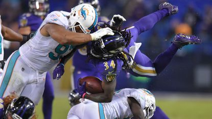 Ravens' #34 Alex Collins gets the first down on a fourth quarter run. He rushed for 113 yards against the Miami Dolphins as the Ravens won 40-0.