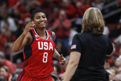 USA Women's National Team forward Angel McCoughtry smiles a she comes off the court during an exhibition game against Louisville Sunday, Feb. 2, 2020, in Louisville, Ky.