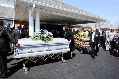 The caskets of Lowell Frederick Blake and and Lou Ruth Blake are moved out of Dunkirk Baptist Church.