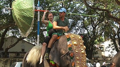 Rachel and Brendon must decorate an elephant for a local festival, and then clean up after her in order to receive the next clue.