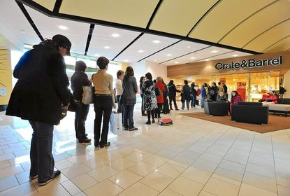 About 80 people waited outside Crate & Barrel for the 9 a.m opening on the day after Christmas. Shoppers came to Towson Town Center to return gifts and take advantage of post-Christmas markdowns.