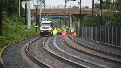 Crews work on repairs to the rail system north of the Linthicum Light Rail Station, which has been closed for flooding. One group wants the Light Rail service in the area to be limited or stopped permanently.