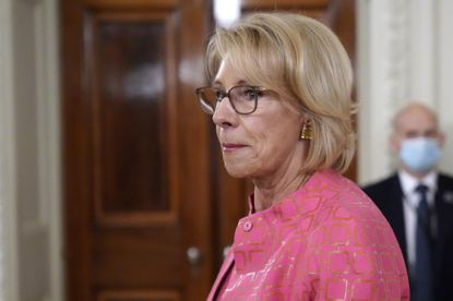 Education Secretary Betsy DeVos arrives for an event in the State Dining room of the White House in Washington.