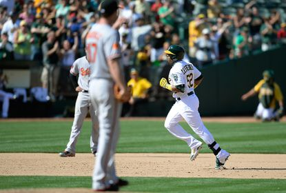 Brian Matusz watches Oakland's Yoenis Cespedes round the bases after he hit a two-run homer off the O's reliever.
