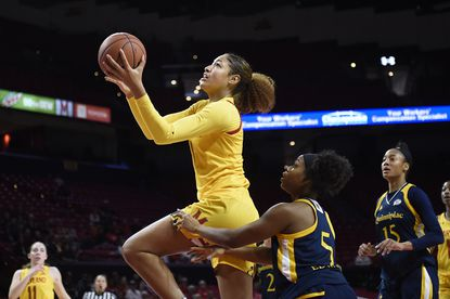 Maryland's Shakira Austin drives to the basket ahead of Quinnipiac's Shaq Edwards during the first half Sunday, Nov. 24, 2019 in College Park.