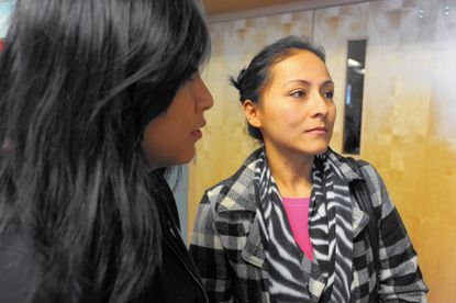 Left to right, Lytzi Monsalvo, translates for her mother, Rosalinda Monsalvo, after attending a CASA de Maryland information session on immigration relief at Patterson High School. They live in Baltimore. The orientation explains who qualifies and the paperwork needed to apply in the spring of 2015.