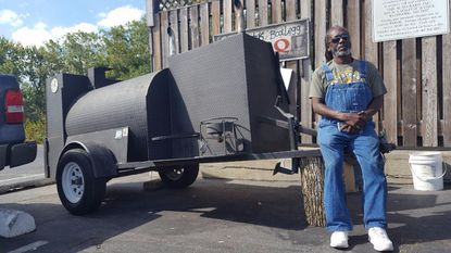 """Duane """"Shorty"""" Davis and his grill at the Corinthian Restaurant and Lounge on Saturday. The grill had been stolen but Davis found it."""