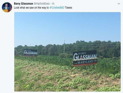 Harford County Executive Barry Glassman put up two signs Wednesday on the main route to Crisfield, site of the annual J. Millard Tawes Crab and Clam Bake which Glassman attended, along with other polticians from around the state.